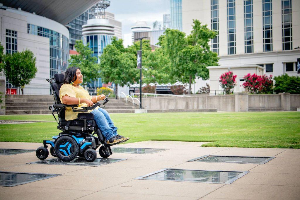 Young woman in power wheelchiar